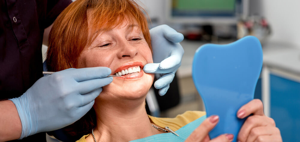 senior-woman-in-dental-office-dentist-smile